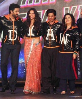 Deepika Padukone in Orange Saree and Black Jacket with Happy New Year Team