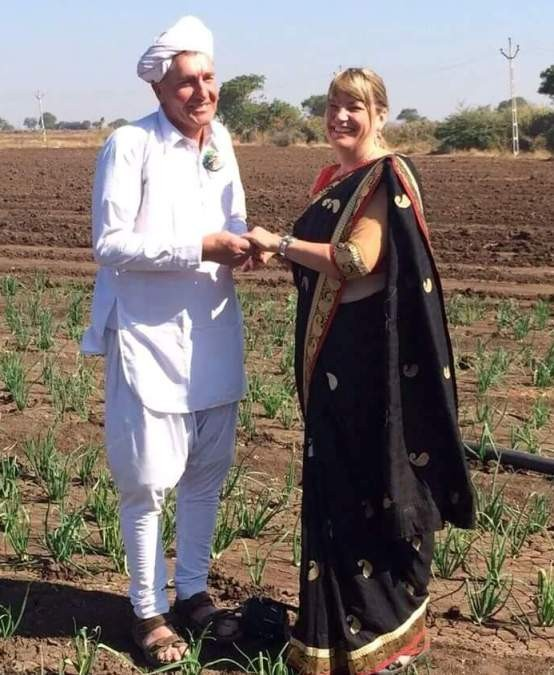 Foreign Lady with Gujarati Village Farmer India Images