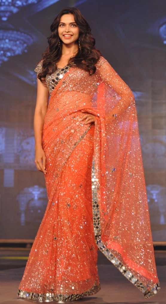Deepika Padukone in Orange Transparent Saree.jpg